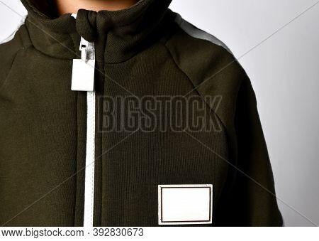 Closeup Shot Zipper And Collar Of Warm Winter Or Autumn Jumpsuit Attire For Kid. Outerwear, Sportive
