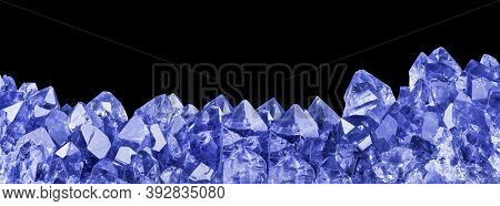 macro photo of blue sapphire crystals isolated on black background