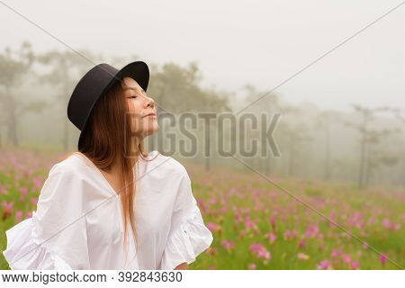 Portrait Of A Woman Relaxing In The Garden Siam Tulip