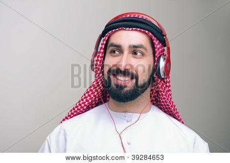 Arabian middle eastern guy with headphones enjoying music