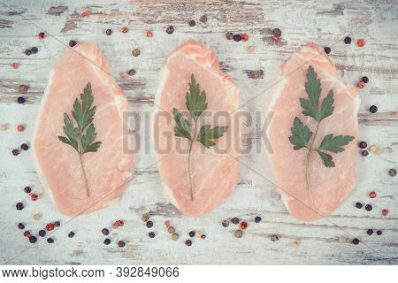 Slices Of Fresh Raw Loin With Parsley And Pepper For Cooking