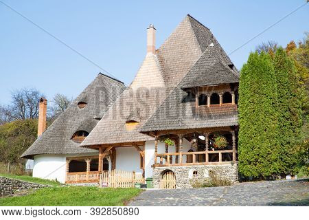 BARSAN, ROMANIA - OCTOBER 28, 2020: View of Barsana Wooden Monastery site in Maramures County, Romania.