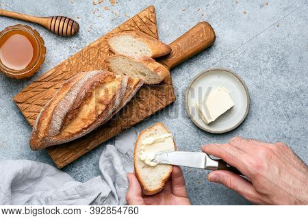 Spread Butter On Baguette Bread. Bread And Butter Toast