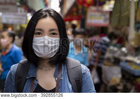 Asian Woman Wearing Surgical Face Mask Protective For Spreading Of Disease Virus Covid-19 Or Coronav
