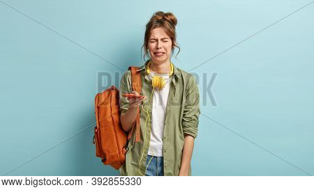 Miserable Dejected Hipster Girl Cries And Sobs From Despair, Holds Modern Smart Phone, Has Problem,