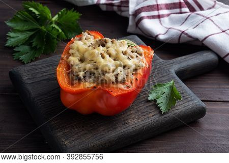 Stuffed Sweet Peppers With Rice Mushrooms And Cheese With Herbs. Baked Halves Of Red Peppers With Fi