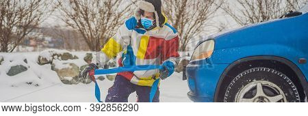 Man With Towing Rope Hooks Near Towed Car Wear Medical Masks Due To The Covid-19 Coronavirus Banner,