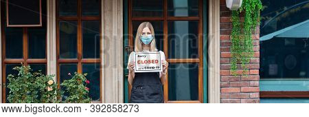 Caucasian Waitress Woman Wearing Medical Mask Holds Sorry Were Closed. Coronavirus Pandemic. Governm