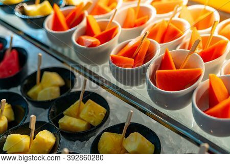 Tropical Fruit Buffet At Event In Restaurant. Catering Food. Fresh Papaya, Pineapple And Watermelon