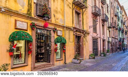 Bosa, Sardinia, Italy - December 29 2019: Central Street During The Evening In The Little Medieval T