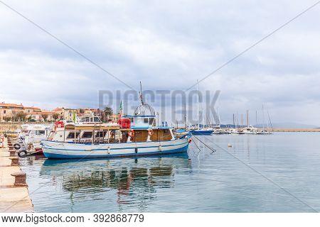 Alghero, Sardinia Island, Italy - December 28, 2019: Sailing Boats In The Harbor Of Alghero, Sardini