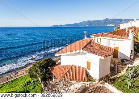 Porto Alabe, Sardinia Island, Italy - December, 12, 2019: Beautiful White Holiday House Along The Be