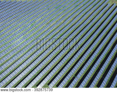 Aerial View Of Solar Power Plant. Renewable Energy Theme. Solar Panels From Above. The Concept Of Ec