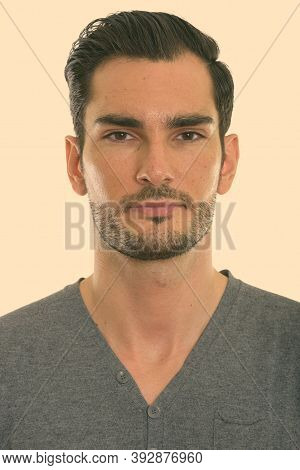 Studio Shot Of Face Of Young Handsome Man