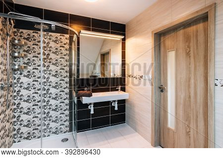 Beautiful Small Bathroom In Attic Of Family House. Bathroom Has Large Glass Shower,double Basin With