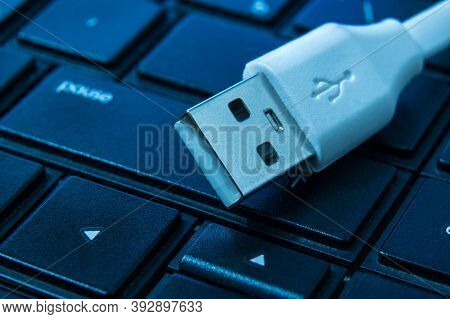 Usb Charger Cable On Computer Keyboard Close Up Designed For Connection Or Charger