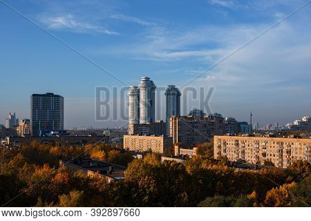 Urban Landscape With Old And New Housing During Sunny Day With Foggy Clouds And Blue Sky. In Foregro