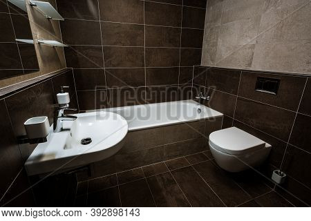 Small Bathroom In The City Apartment With Wash Basin, Bath, Toilet And All Furnishing. Paving And Ti