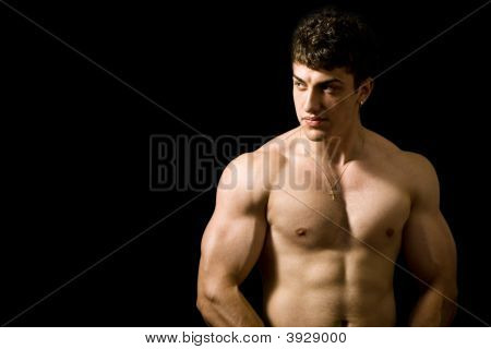 Muscular Man On Black Background