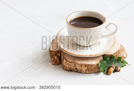 Acorn Coffee On A White Background. Still Life With Black Coffee, Oak Leaves And Acorns. Caffeine Su