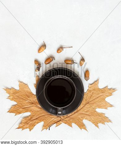 Black Coffee With Dry Leaves And Acorns On A White Background. Autumn Still Life. Acorn Coffee Witho