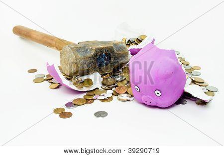 Safe-shaped pig broken with sledgehammer