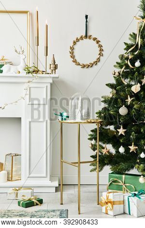 Stylish Christmas Composition At Living Room Interior With White Chimney, Christmas Tree And Wreath,