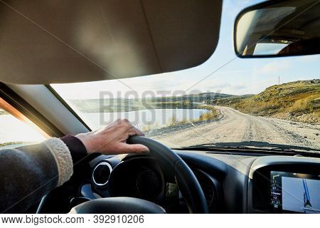 Car Salon, Steering Wheel, Hand Of Woman On It, Mirror And View On Landscape With Road And Nature At