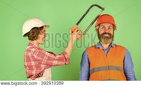 Annoying Edits. Couple Renovating Home. Man And Woman Wear Safety Helmet. Home Renovation. She Is Sa