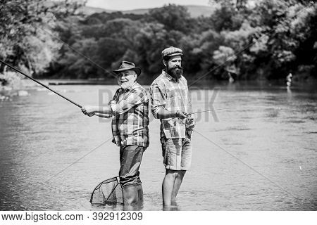 Hobby Matters. Two Happy Fisherman With Fishing Rod And Net. Hobby And Sport Activity. Trout Bait. M