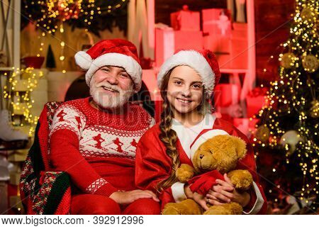 Toys Collection. Happy Childhood. Lovely Present. Child Enjoy Christmas With Grandfather Santa Claus