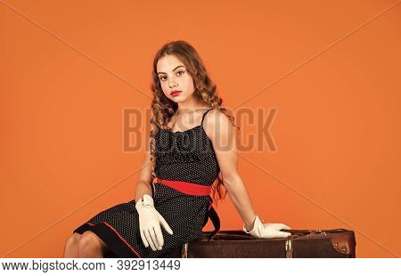Fashion Is Her Life. Wanderlust And Adventure. Traveler Kid Sit On Vintage Suitcase. Travel Concept.
