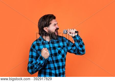 Vocal Warm Up. Brutal Guy In Karaoke Club. Male Singing In Mic. Handsome Hipster On Party. Music. Ma