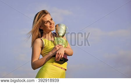Gold Prize. Cute Athlete Being Awarded With Cup. First Place Award And Success. Girl Hold A Golden T