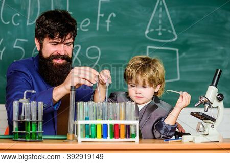 Genius Kid. Teacher Child Test Tubes. Achieving Developmental Milestones Way Before Predicted Sign T