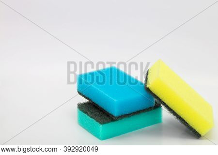 Colored Washcloths For The Kitchen. Cleaning Of The Apartment. Cleaning Sponges On A White Backgroun