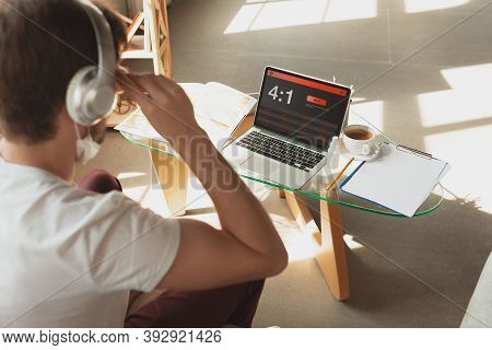 Man Using Laptop, Screen With Mobile App For Betting. Device With Match Results On Screen. Watching