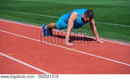 Sports And Healthy Lifestyle Routine. Sport Success. Male Athlete Do Morning Exercise. Pushups Worko