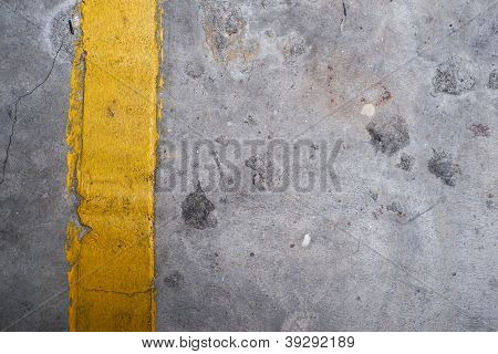Grunge Textured Concrete Floor With Yellow Line