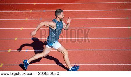 Sportsman Male In Sportswear Run Fast Sprinting On Running Track, Distance