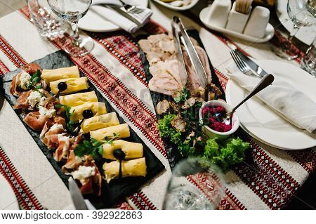 The Holiday Table Cheese, Meat, Salads. Served Table With Food. Festive Table. Wedding Table, Food.