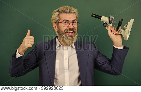 Facilitate Academic Progress. Fascinating Research. Teacher With Microscope. Man Hipster Classroom C