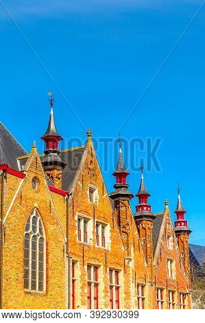 Traditional Medieval Brick House Exterior Against Blue Sky In Brugge, Belguim With Copy Space