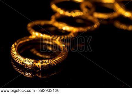 Traditional Expensive Gold Bangle Jewelery On Black Background For Diwali, Dhanteras Celebration Sho