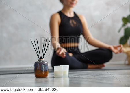 Portrait Of Sporty Young Woman Doing Exercises On Yoga Lesson At Home. Beautiful Girl Practicing Eas
