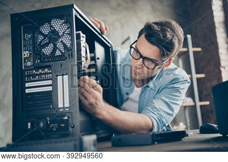 Close-up Portrait Of His He Nice Attractive Focused Professional Guy Skilled Technician Repairing Ha