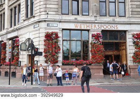 London, Uk - July 13, 2019: People Visit Wetherspoons Pub In London. It Is A Typical London Pub. The