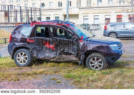 Wrecked Crumpled Car From The Right Side After A Severe Accident With A Distorted Body And Broken Wi