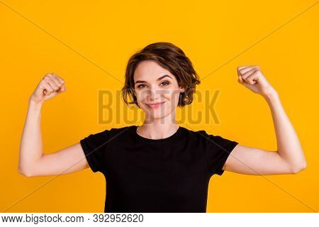 Close-up Portrait Of Attractive Content Strong Cheery Girl Demonstrating Strong Muscles Isolated Ove