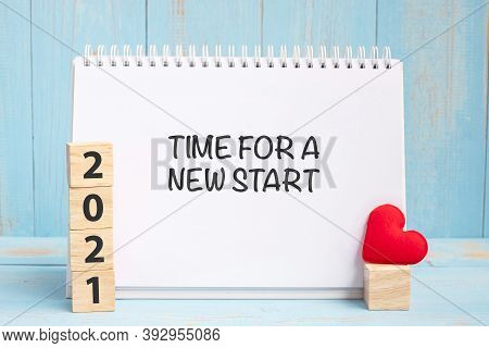 Time For A New Start Words And 2021 Cubes With Red Heart Shape Decoration On Blue Wooden Table Backg
